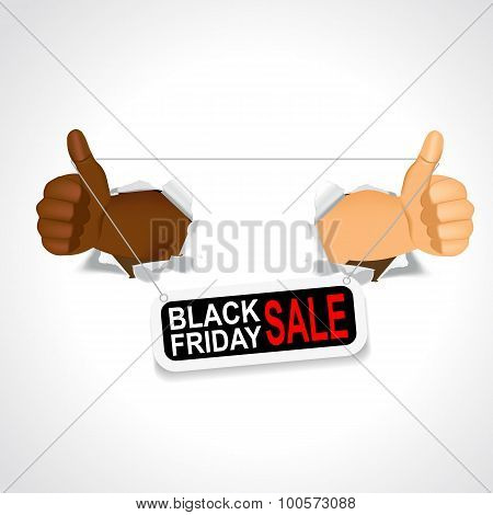 black hands holding a black friday sale banner