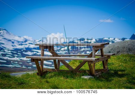 VALDRES, NORWAY - 6 JULY, 2015: Fantastic picninc spot wooden table along roadway crossing Valdresfl
