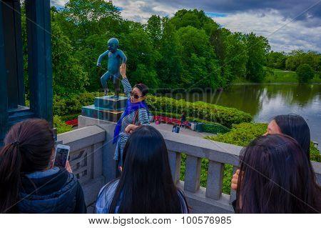 OSLO, NORWAY - 8 JULY, 2015: Famous sculpture Sinnataggen located in Vigelandsparken, sorrounded by