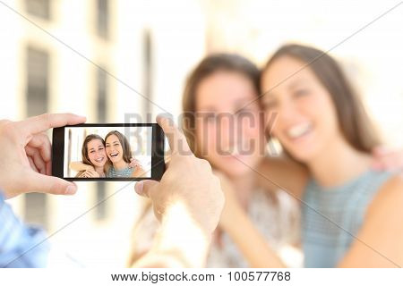 Friends Taking Photos With A Smart Phone