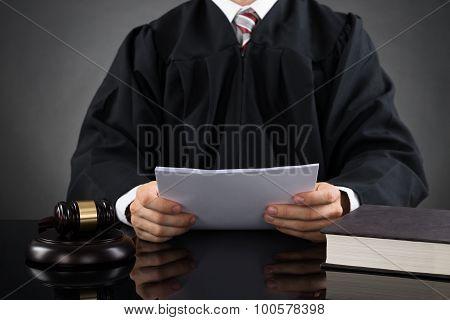Judge Reading Paper