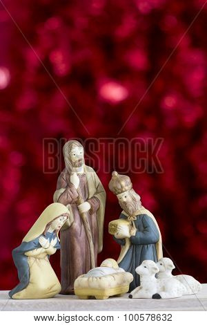 Nativity Scene on Red Background with Copy Space Vertical