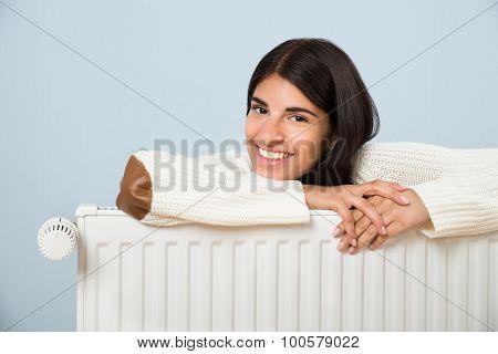 Woman Leaning On Radiator
