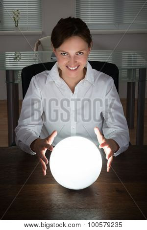 Businesswoman Looking In A Crystal Ball
