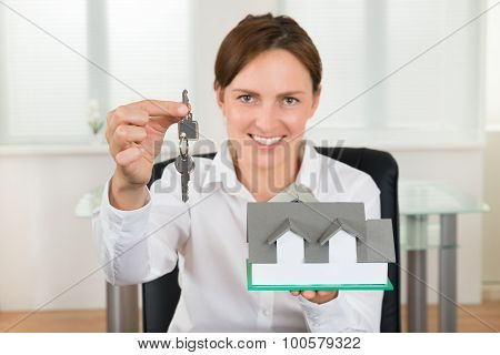 Businesswoman Holding Key And House Model
