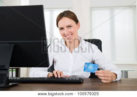 Businesswoman With Credit Card And Computer