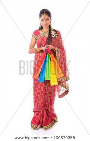 Indian girl in traditional sari shopping for diwali festival, full length standing isolated on white background.