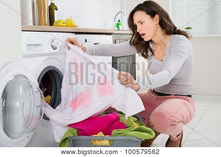 Woman Looking At Stained Cloth