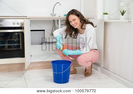 Woman Squeezing Wet Cloth In The Bucket