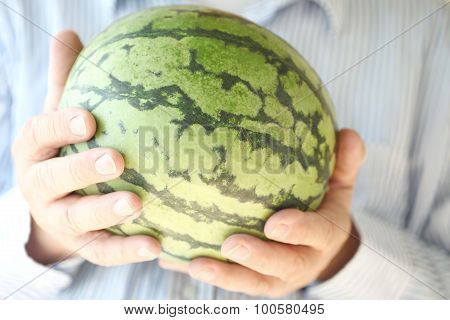 Watermelon held by a man