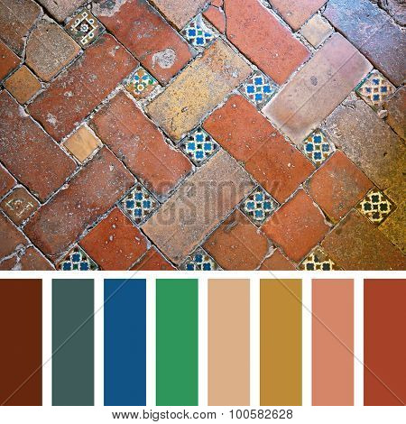 Floor detail of the Alhambra Palace, Granada, Spain. In a colour palette with complimentary colour swatches.