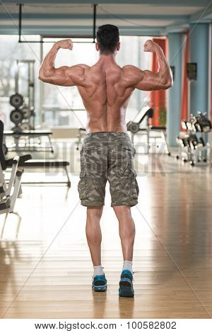 Ripped Mature Man In Modern Fitness Center