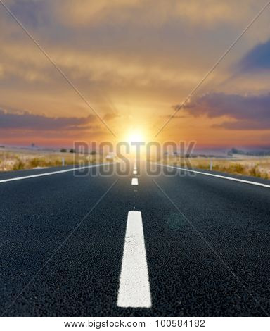 Asphalt road and the sunset
