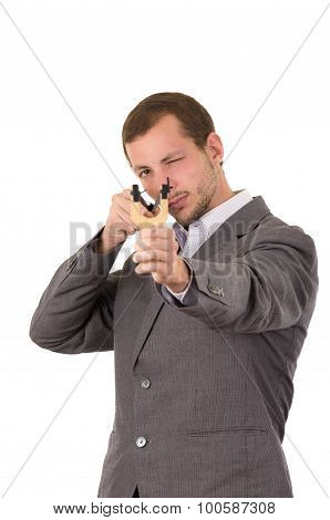 Handsome buisness man concentrated aiming a slingshot isolated over white background