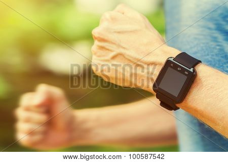 Runner With Smart Watch Outside In Nature