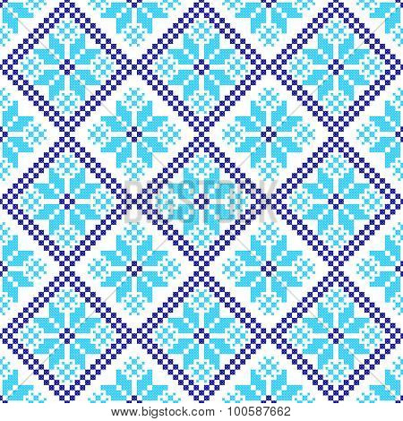 embroidered handmade cross-stitch ethnic Ukraine pattern. winter color