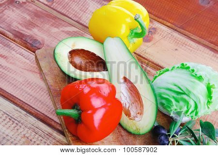 vegetables prepared for use on wooden table with oil