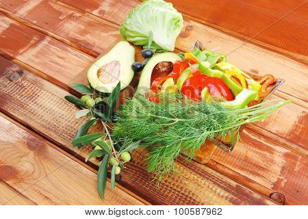uncooked fresh vegetables prepared on wooden table