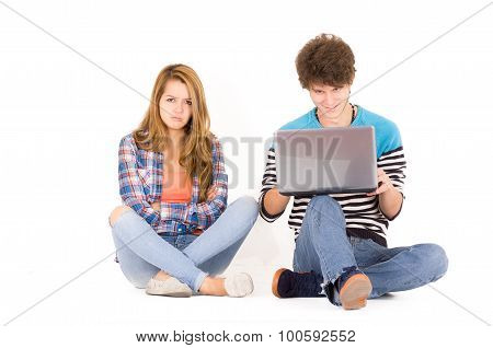 Portrait of attractive young couple in love man and woman isolated over white background sitting on