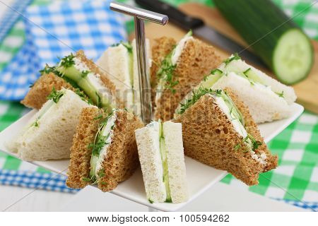 White and brown cream cheese and cucumber sandwiches