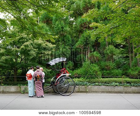 Tourists Ride Rickshaw Service In Kyoto