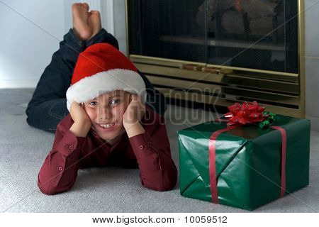 Eight Year Old Boy In Santa Hat
