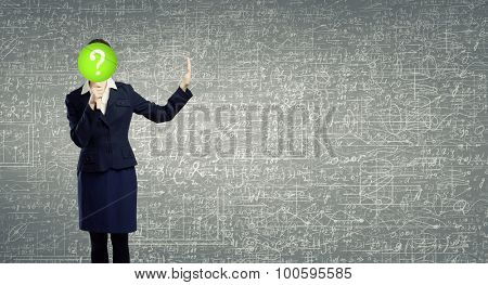 Businesswoman hiding her face behind paper mask with question sign and showing stop gesture