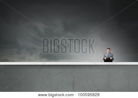Young handsome businessman with briefcase in hands