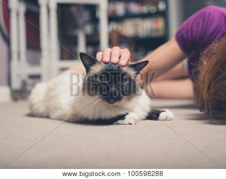 Cat And Woman On Floor