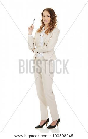 Smiling businesswoman holding a pen.