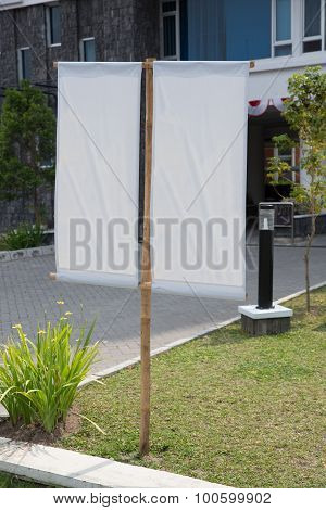 Blank White Banner On A Grass Yard In Front Of An Office, Mock Up