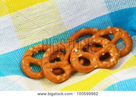 Salty pretzels on colorful cloth with copy space
