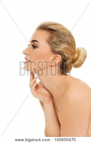 Portrait of young blonde woman, isolated on white.