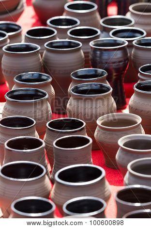 handmade ceramic pottery in a roadside market ** Note: Shallow depth of field