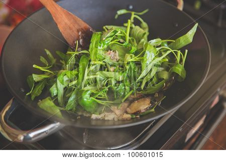 Adding Water Spinach Into Burning Herb In Hotpot, Close Up