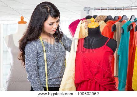 Fashion Designer Working On Draft