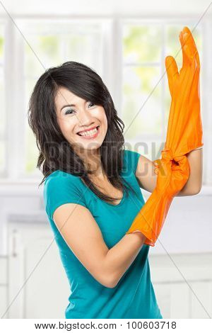 Beautiful Young Asian Woman Wearing Rubber Gloves Ready To Do Chores