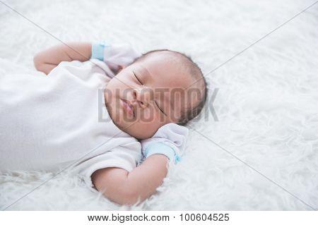 Newborn On The Bed