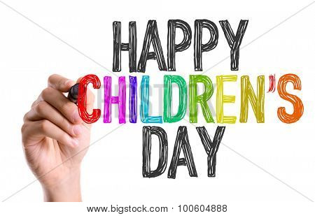 Hand with marker writing the word Happy Childrens Day