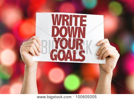 Write Down Your Goals placard with bokeh background