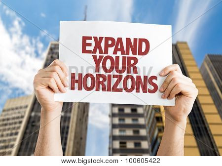 Expand Your Horizons placard with cityscape background