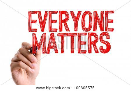 Hand with marker writing the word Everyone Matters