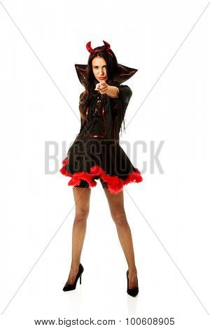Woman wearing devil clothes pointing on you.