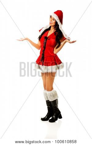 Attractive santa woman holding something invisible in hands.