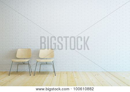 room with two modern chair and white brick wall