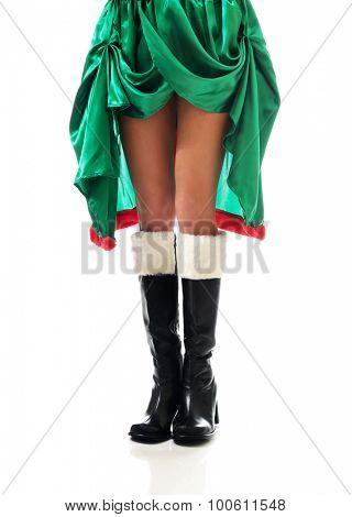 Slim woman legs wearing elf boots.
