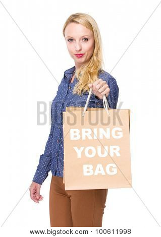 Woman with shopping bag and showing phrase bring your bag