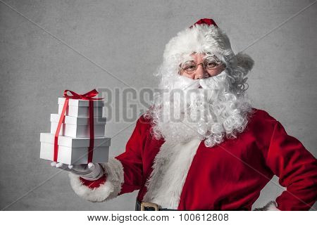 Santa Claus with a small stack of gifts