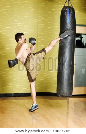 Young man boxing in gym