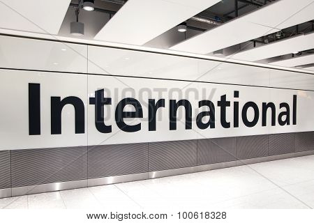 LONDON, UK - MARCH 28, 2015: International arrivals sign. Interior of  Heathrow airport Terminal 5.